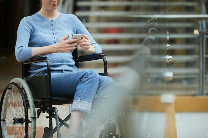 Disabled woman reading a message
