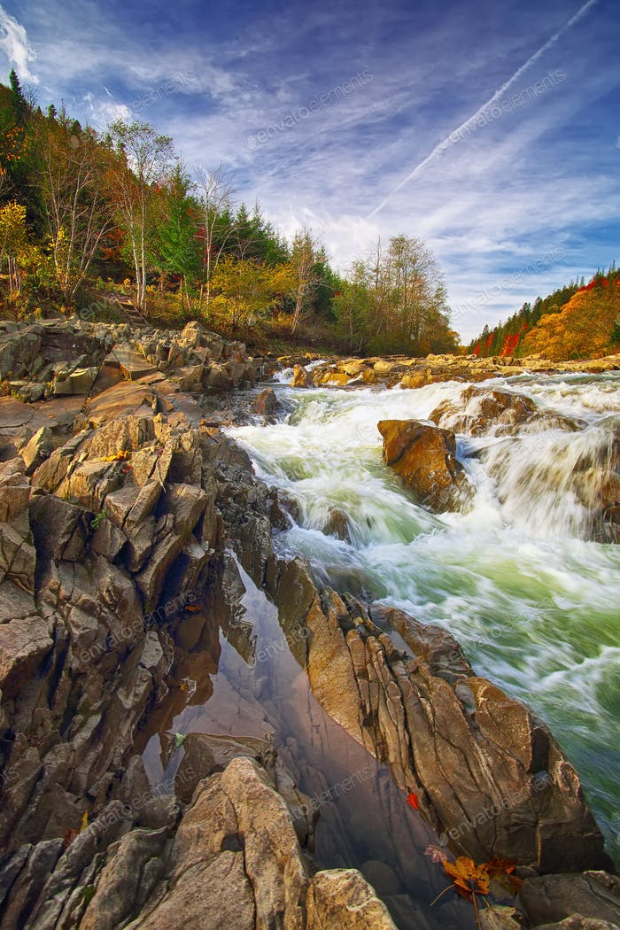 Mountain fast flowing river stream of water in the rocks