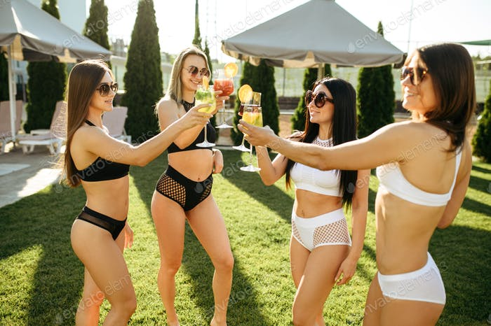 Sexy women with fresh coctails, pool party