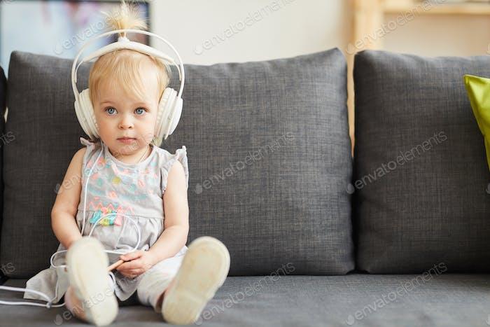 Little girl addicted to smartphone
