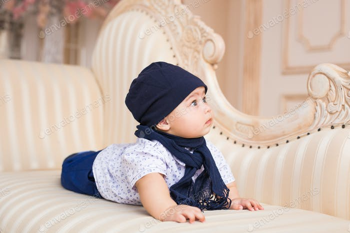 Portrait of a cute baby boy smiling. Adorable four month old child.
