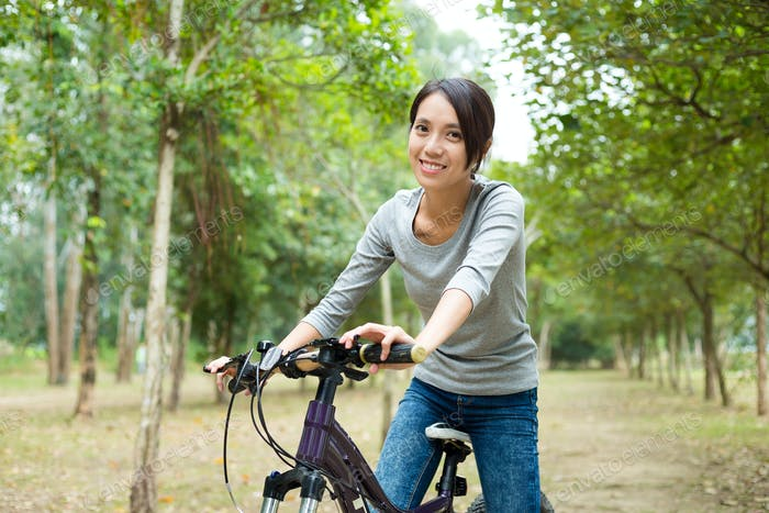 Woman ride a bicycle
