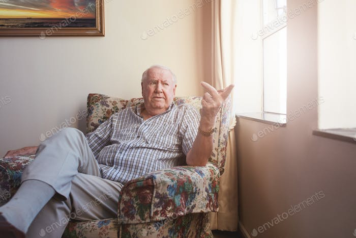 Senior man sitting at assisted living facility
