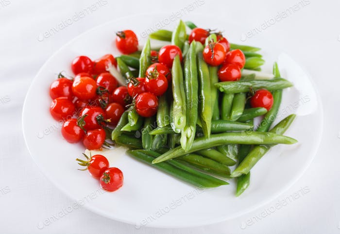 Peppers green beans with cherry tomatoes. Salad