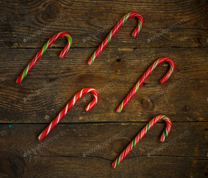 Candy canes on wooden boards