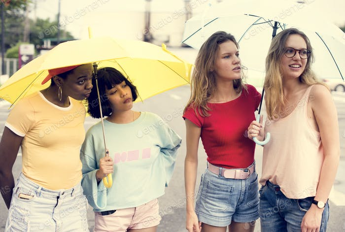 Group of diverse women with umbrella