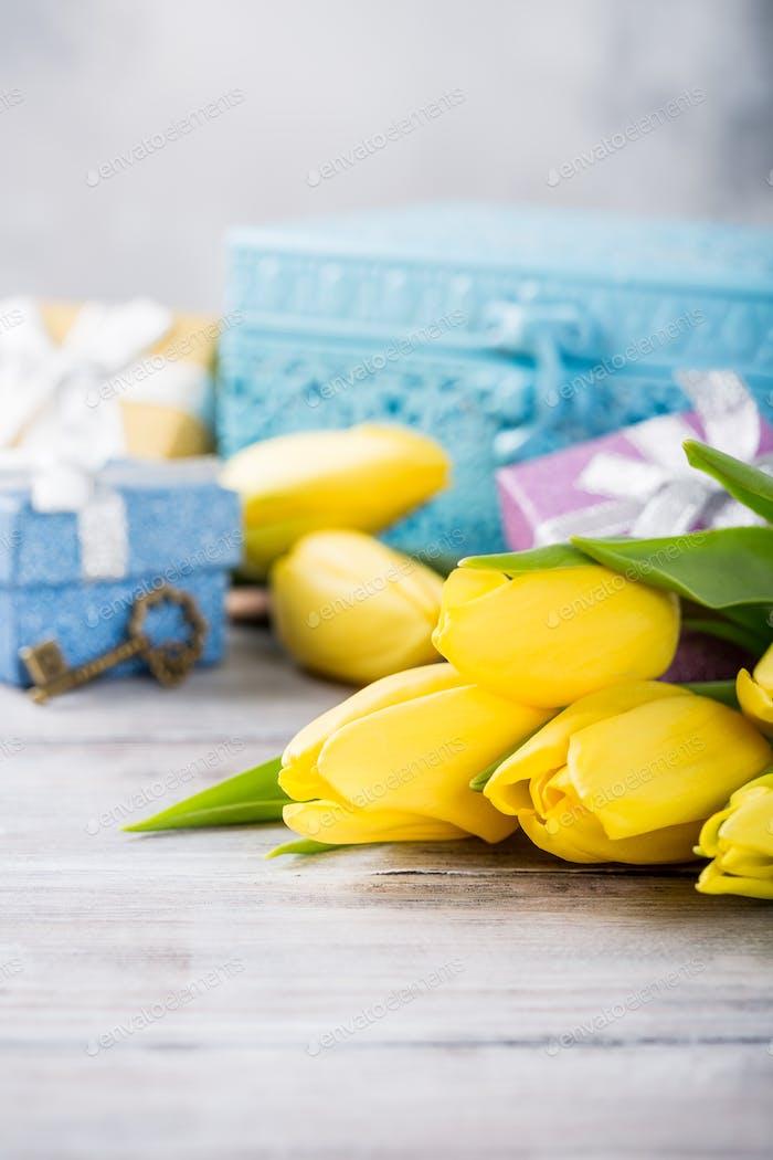 Yellow tulips in blue metal box