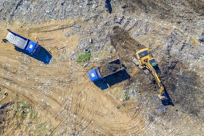 excavator and dump trucks