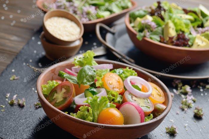 Vegetable salad of lettuce, cherry tomatoes, radish, cucumber, o