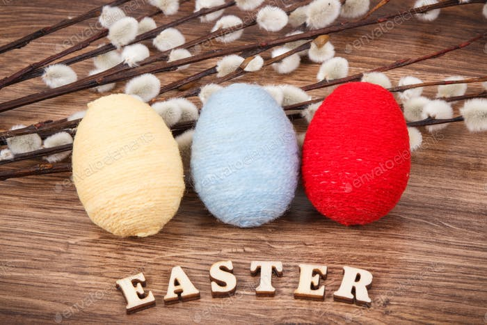 Colorful eggs and Easter catkins as festive decoration