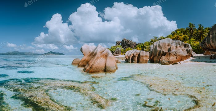 Impressive cloudscape at beautiful Anse Source d'Argent beach, La Digue Island, Seychelles