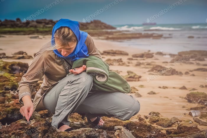 Woman collecting shells