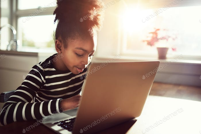 Young African girl amusing herself at home