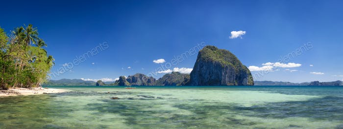 Palawan, Philippines. Tropical panorama view of El Nido coastline with huge rocky island on the