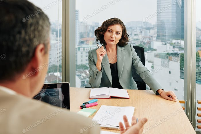 Businesswoman Working With Client
