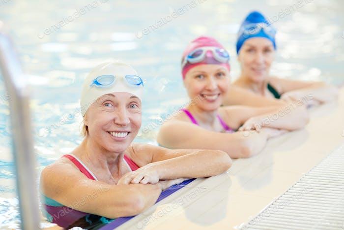 Three Mature Women Posing in Pool