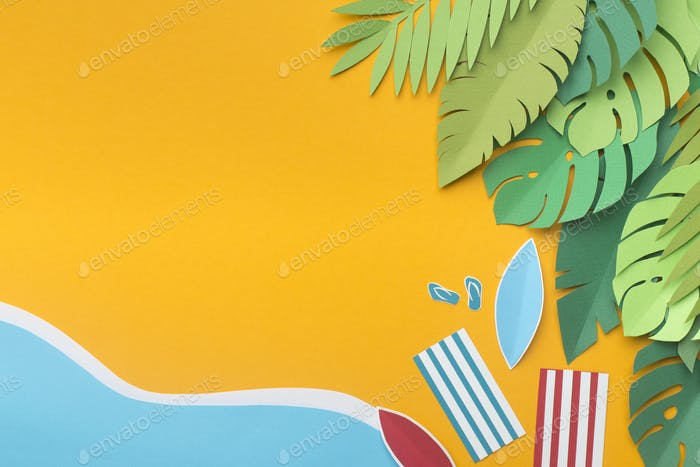 Tropical island beach with two towels from the top