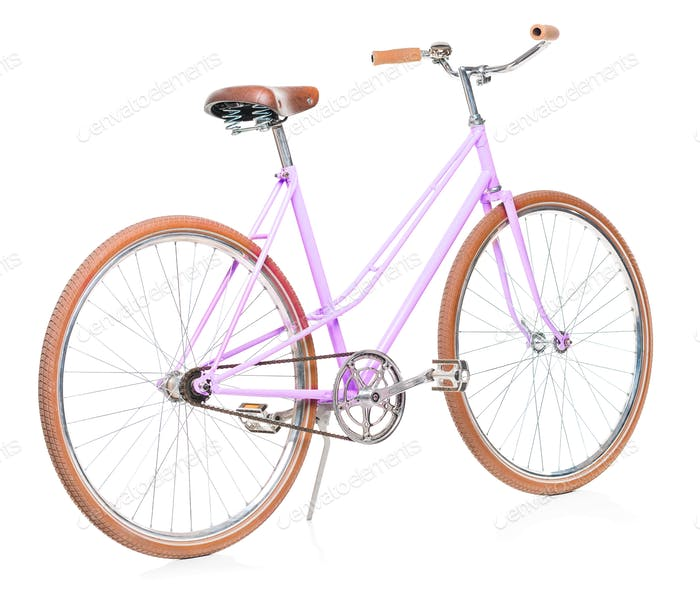Stylish womens pink bicycle isolated on white
