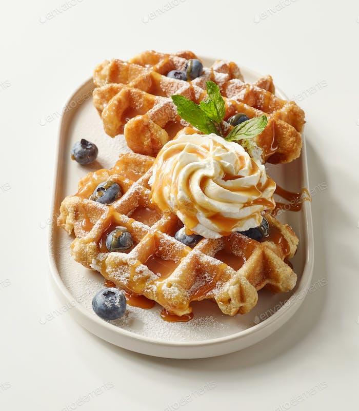 plate of belgian waffles dessert
