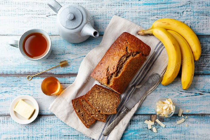 Healthy Vegan Oat and Banana Loaf Bread, Cake. Blue Wooden Background. Top view.