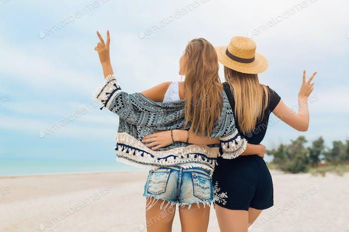 stylish beautiful women on summer vacation on tropical beach
