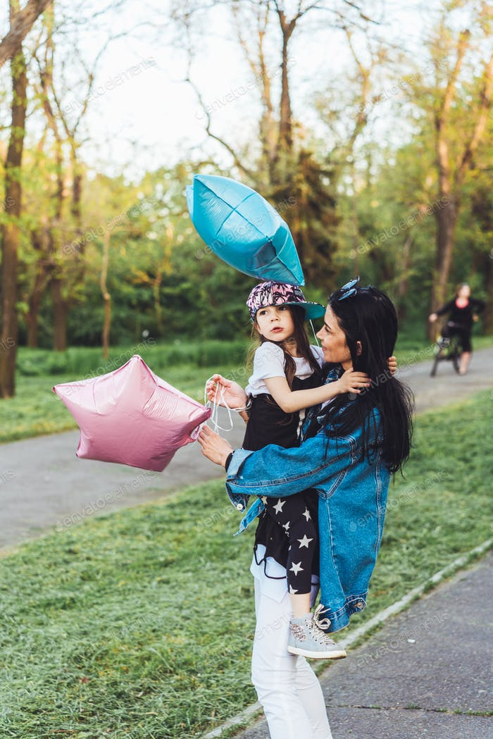 mom and little girl have fun