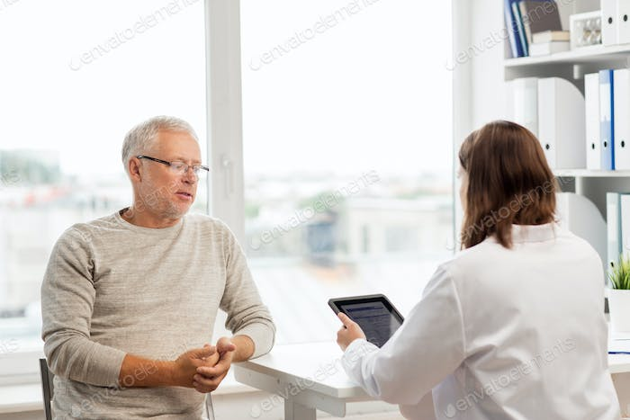 senior man and doctor with tablet pc at hospital
