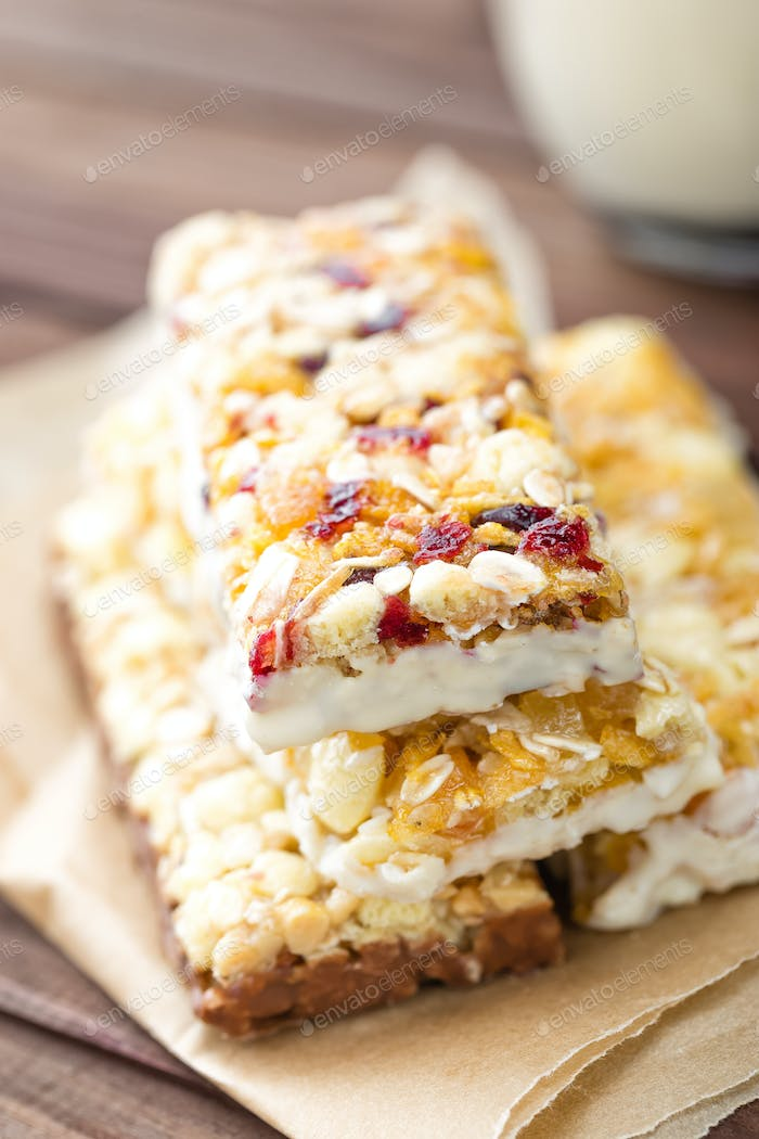 Delicious granola bars with oat, honey and yogurt, healthy food for breakfast