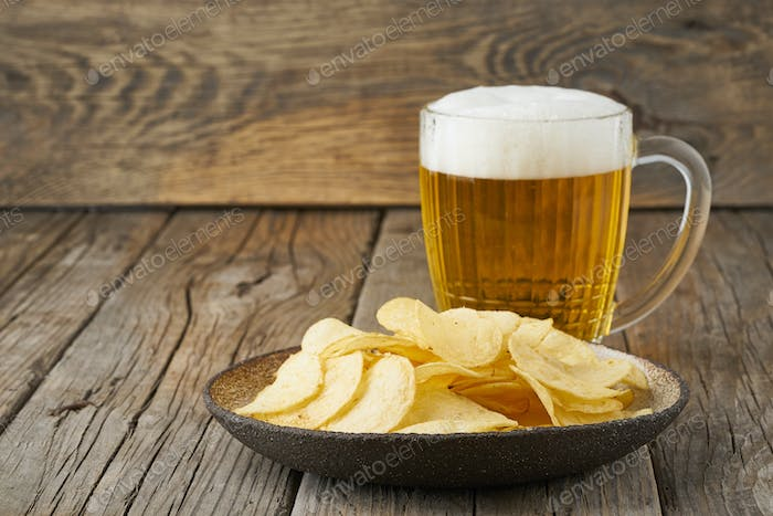 Thumbnail for crisp in bowl with beer in glass, top view, wooden background, copy space