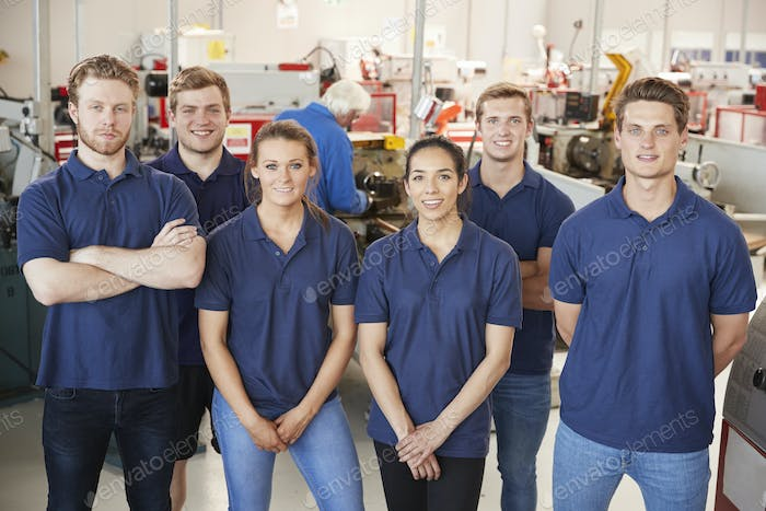 Apprentice engineers in their workplace, group portrait