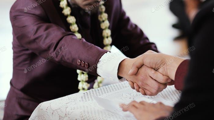 Shaking hand on Islamic Wedding