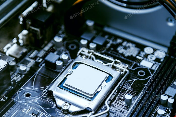 Motherboard of a personal computer, processor close-up. Modern technologies, computer architecture