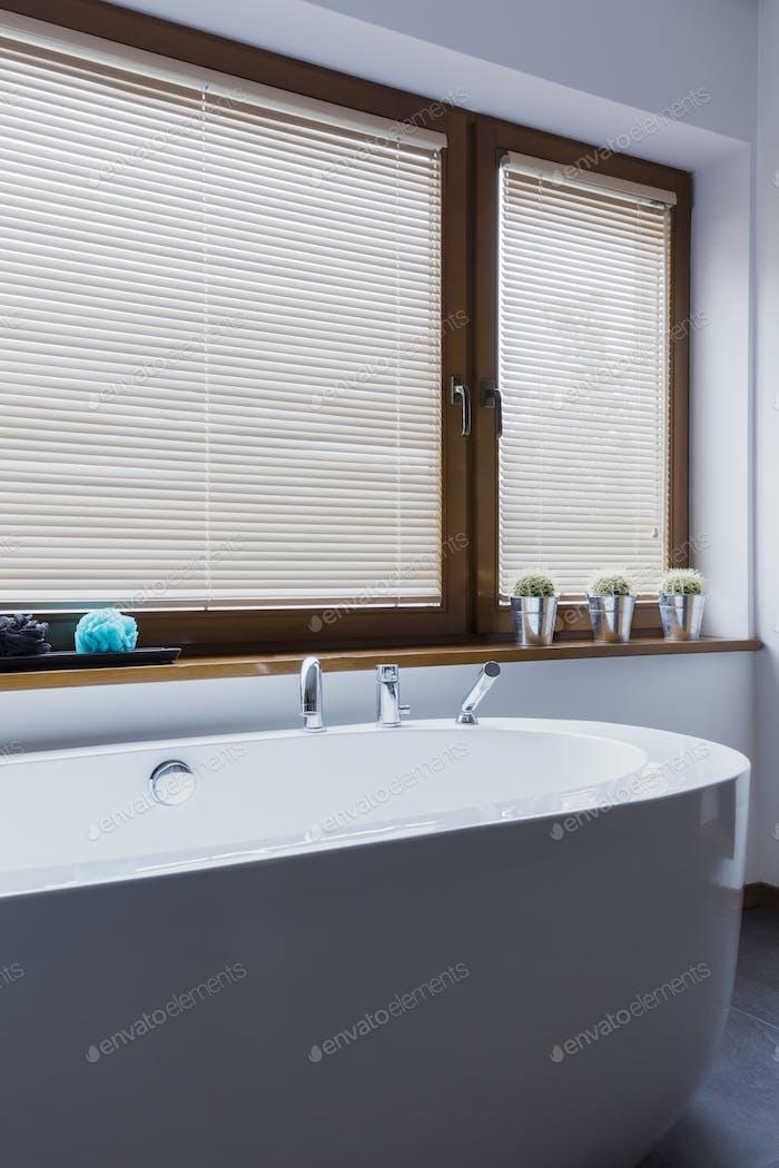 Modern bathroom with freestanding bathtub