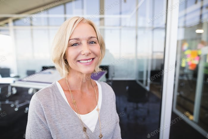 Portrait of mature businesswoman smiling in office