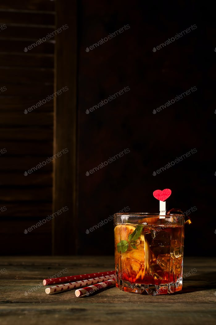 Blood Orange Margarita coctail with ice and mint on wooden background