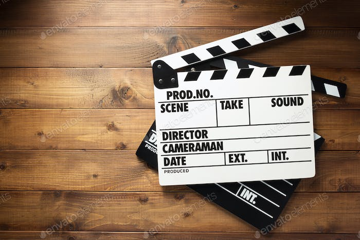 movie clapper board at wooden background