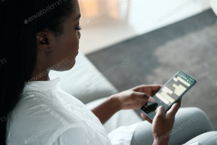 Black Woman Text Messaging With Cellphone