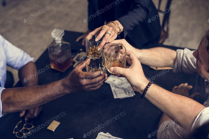 Hand toasting an alcohol together