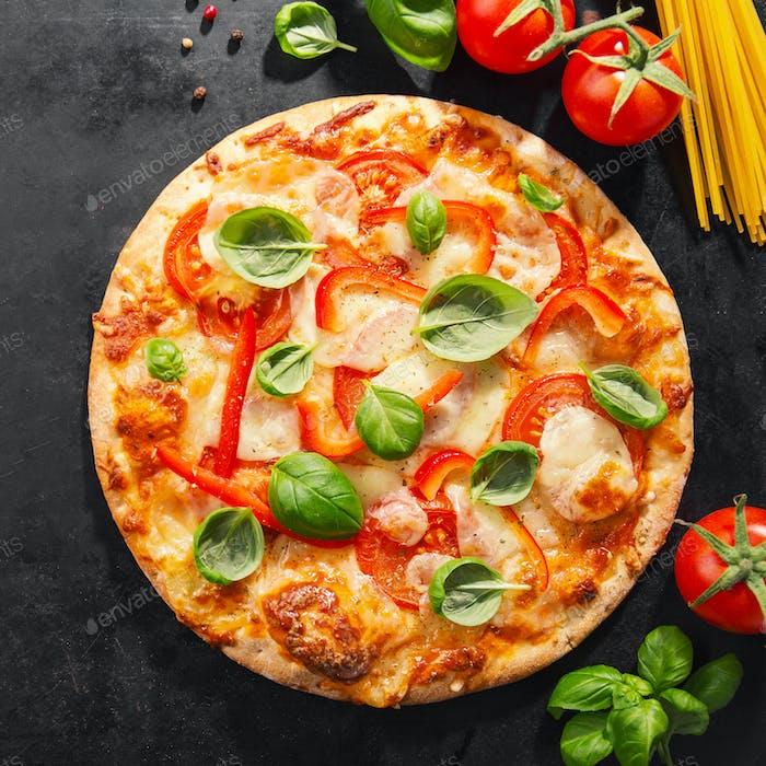Tasty vegetarian pizza on dark background