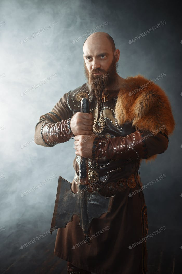 Viking with axe, nordic barbarian image