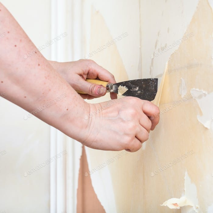 Scrape the backing off the wall