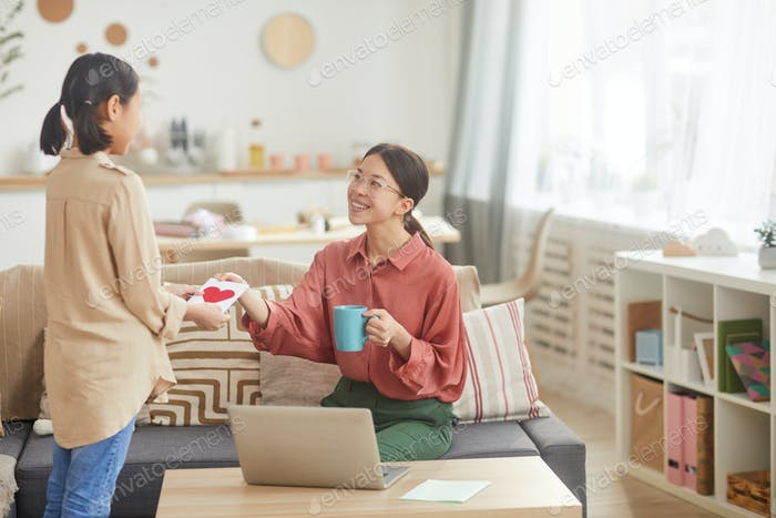 Happy Woman Getting Card From Daughter