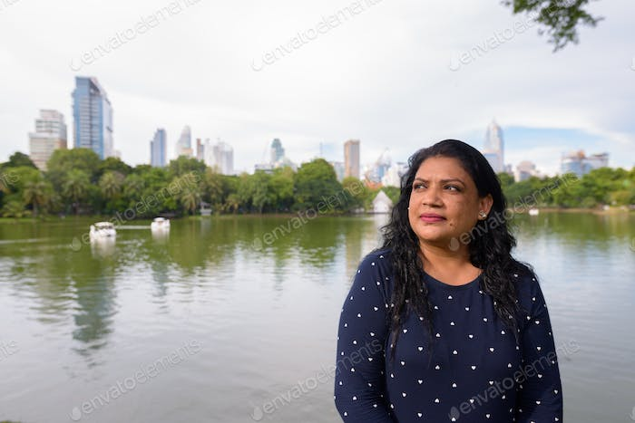 Portrait of mature Indian woman relaxing at the park