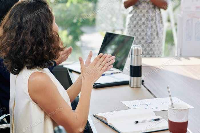Entrepreneur clapping to speaker