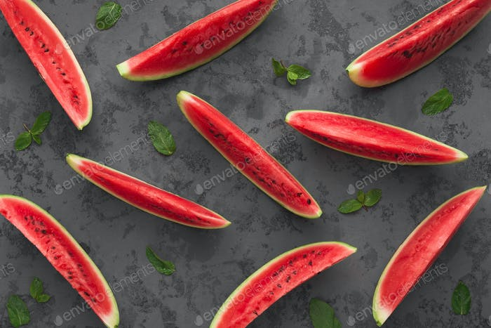 Red watermelon slices on dark grey background