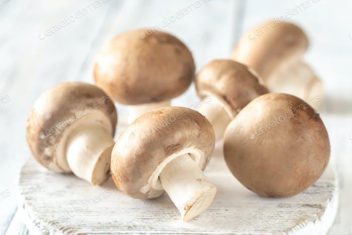 Champignon mushrooms on the wooden board