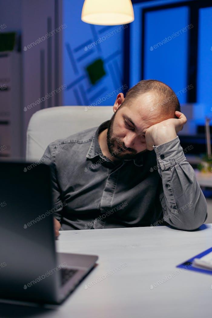 Businessman sleeping in company office