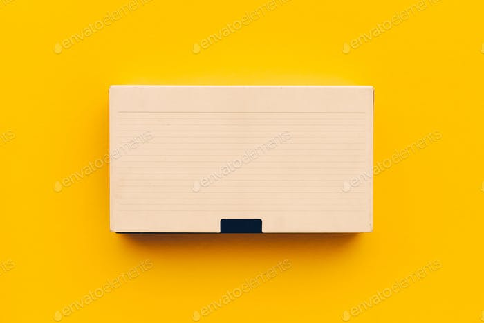 VHS video cassette on yellow background