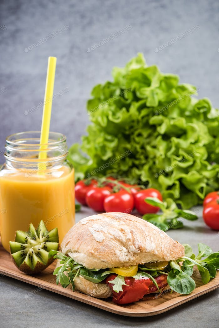 Healthy sandwich bun,smoothie on breakfast tray