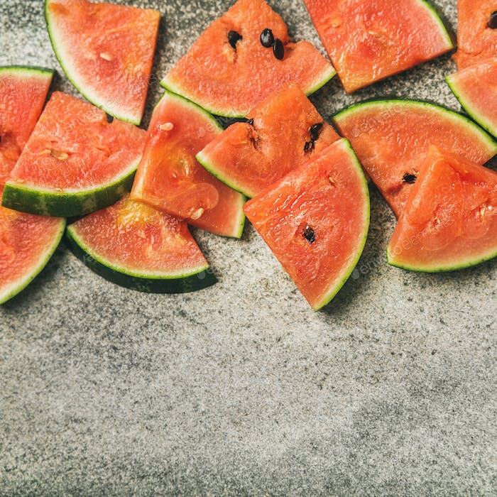 Juicy watermelon pieces over concrete stone background, square crop